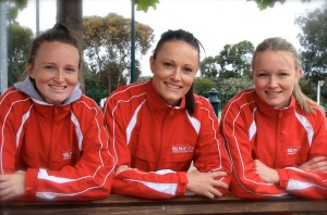 Three of a kind: The Dusting sisters, Jess, Nat and Amie, are set to clock up 1000 games for the Warrandyte Netball Club.
