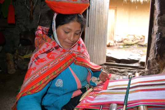A talented weaver working in her home, Chaullacocha, Peru